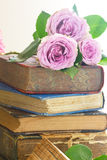 Old books with rose flower Stock Photo