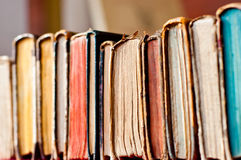 Old books row. Old books in a row background Royalty Free Stock Photography