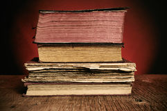 Old books on a rustic wooden table Stock Photography