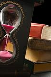 Old books and sand glass Royalty Free Stock Photo