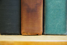 Old Books on a Shelf. Cropped view of some old books on a bookshelf Royalty Free Stock Photos