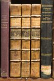 Old books on the shelf. Close up Stock Image