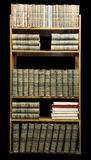 Old books on shelf Stock Images