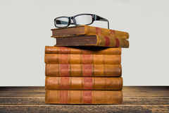 Old books shelf isolated on wooden table Royalty Free Stock Photo