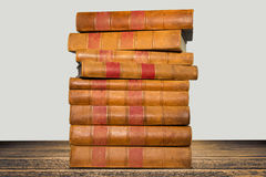 Old books shelf isolated on wooden table Stock Photography