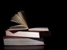 Old books, side lit. Dark lighting. Royalty Free Stock Photography
