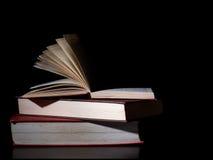 Old books, side lit. Dark lighting. Royalty Free Stock Photography
