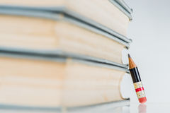 Old Books and Small Perfect Pencil Royalty Free Stock Photos
