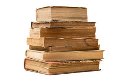 Old books. Some old books stacked on a white background Stock Image