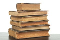 Old books stack. A pile of very old, worn, yellowed books stock image