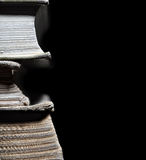 Old books in stack isolated. On black background Stock Photos
