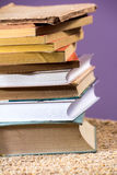 Old books. Stack of some old books piled on a table royalty free stock image