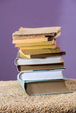 Old books. Stack of some old books piled on a table stock photography