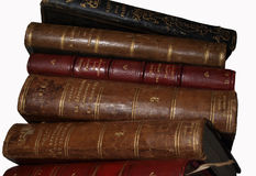 Old books stacked. Low-angle close-up view of a stack of old books Stock Image