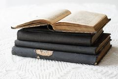Old books stacked on a white table. Old release without titles. White background Stock Image