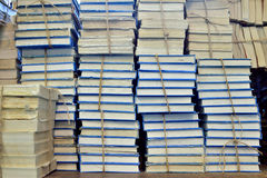 Old books stored. Pile of books bound with rope in library depot store on the table Stock Photo