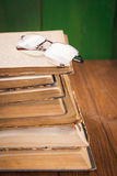 Old books in studio. Some open old books with glasses in studio Stock Images