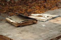 Old books on a table stock photos