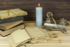 Old books to read. Studying old dictionaries. Historical Library, reading by candlelight Royalty Free Stock Images