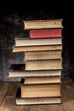 Old Books Tower. Pile on Wood Table royalty free stock images
