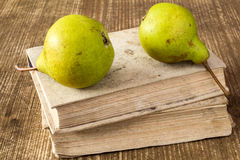 Old books with two green pears Royalty Free Stock Image
