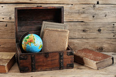 Old books in vintage chest closeup Stock Image
