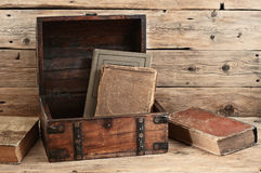 Old books in vintage chest closeup Royalty Free Stock Images