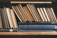 Old books in a vintage library Stock Photo