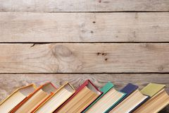 books on the wooden background royalty free stock photo