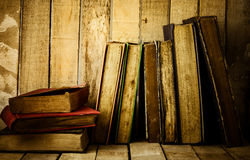 Old books on the wooden background. Royalty Free Stock Photography