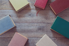 Old books on wooden background. View from above Stock Images