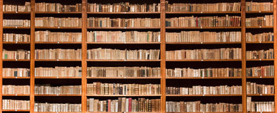 Old books in wooden bookcase royalty free stock photos