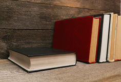 Old books on wooden shelf Royalty Free Stock Photography