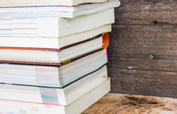 Old books on a wooden shelf Stock Image