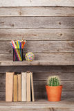 Old books on a wooden shelf Royalty Free Stock Photography