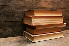 Old books on wooden shelf Stock Images