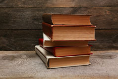 Old books on wooden shelf Stock Photography