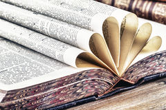 Old books. On wooden table stock image