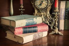 Old books with historical clocks royalty free stock photography