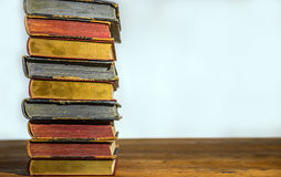 Old books on the  wooden table Stock Photography