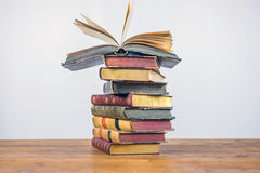 Old books on the  wooden table Royalty Free Stock Photo