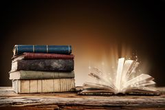 Old books on wooden table Royalty Free Stock Photos