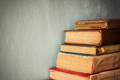 Old books on a wooden table. retro filtered image. Stock Photography