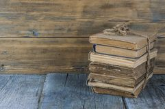 Old books on wooden table royalty free stock photo