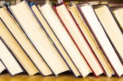 Old books with yellow pages on the shelf stock photography
