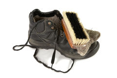 Old boot with  shoe brush Royalty Free Stock Photos