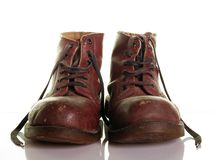 Old boots. Old working boots over white Royalty Free Stock Image