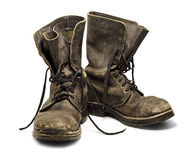 Old boots. Old and dirty military boots isolated on white background Stock Images
