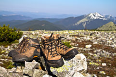 Old boots against of mountain landscape Stock Image