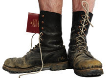 Old boots with legs with money and passport Stock Photo